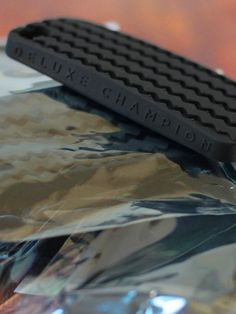 """""""Where the rubber meets your phone""""Paying homage to the legendary Champion Deluxe tread pattern. The iPhone 5 version of our Deluxe case features the words """"DELUXE CHAMPION"""" on the sidewall just like the tires. Each case also features raised volume and power buttons, snug fitting 100% silicone body and openings for headphone and power jacks.Silicone protects your phone from dirt, oil and hard knocks as well as adding grip so you're less likely drop it!"""