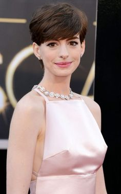 Anne Hathaway 2013 OSCARS. I know there was a lot of buzz about this one...but it didn't help how the dress was sewn in that area...if you know what I mean? :)