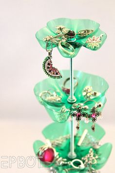 Pretty flower jewelry holder... made from soda bottles!  I so need a dremel tool for my birthday...