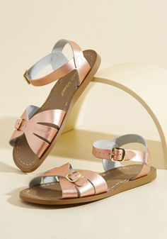 Spritz of Salt Water Leather Sandal in Rose Gold   Mod Retro Vintage Sandals   ModCloth.com When you come dancing across the dunes in these waterproof shoes by Salt Water Sandals, friends are 'shore' to offer up sunny reviews! Crafted from metallic rose gold leather with cutouts at the toes, straps secured with rust-resistant brass buckles, and slim, sand-colored soles, these stylish flats are as classic as they come, and versatile, too.