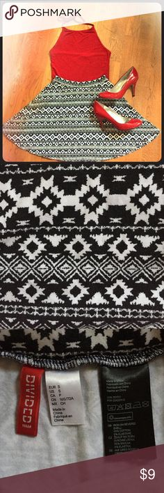Black-and-White Aztec Skater Skirt This circle skirt looks great on everyone any time of the year! It goes with so many things and works for so many occasions. It's in great condition with no flaws. Heels also available in my closet. Comment with any questions! Divided Skirts Circle & Skater