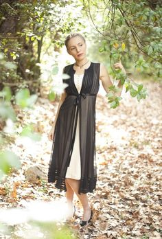 This is a romantic and elegant dress is black silk, and beige dress unde