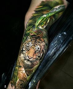 Tigers are icons of beauty, power, and the importance of conservation. The Bengal tiger ranks among the biggest wild cats alive today. It is also known as the Royal Bengal tiger. Below, we are going to mention Bengal tiger tattoo designs and ideas. Tigeraugen Tattoo, 3d Tattoos, Great Tattoos, Trendy Tattoos, Animal Tattoos, Beautiful Tattoos, Body Art Tattoos, Tattoos For Guys, Amazing Tattoos