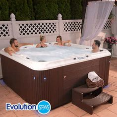 Evolution Spas Hilton UV or Spa 4 PumpsMulticolor LED Lighting Lighted Cup Holders & Water CascadesBluetooth Ready Sound System Dimensions: L x W x H Oval Swimming Pool, Oval Pool, Hot Tub Backyard, Backyard Pool Landscaping, Landscaping Ideas, Underwater Lights, Brown Cabinets, Solar Water Heater, Spa Offers