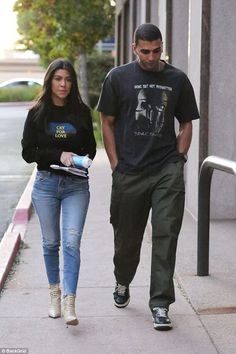 Style: The reality star wore a long-sleeved black top with a graphic and text that read, 'Cry for Love,' with light blue jeans with a tear