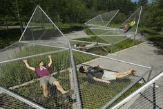 Designed by Jane Hutton & Adrian Blackwell, Dymaxion Sleep (curled up) was exhibited in Metis Garden Festival between 2009-2011. Dymaxion Sleep (curled up) is a structure of nets suspended abov… #landscapingarchitecture