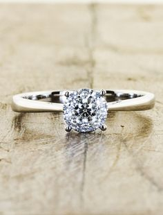 this is pretty and simple and i really like it. its reverse tapered and everything. I really dont want anything too fancy honestly. as long as it doesn't turn my finger green and i have you im happy