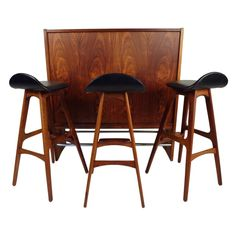 Danish Modern Rosewood Bar and Stools by Erik Buck | From a unique collection of antique and modern dry bars at https://www.1stdibs.com/furniture/storage-case-pieces/dry-bars/