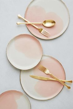 COUNTRY Handmade in Israel. COLOR DETAIL Ivory white, blush pink and gold. DESCRIPTION Organic shaped, white limoges porcelain with a watercolor splash of blush pink. Genuine gold has been hand-painte Ceramic Plates, Ceramic Pottery, Ceramic Art, Pottery Plates, Small Plates, Pink Plates, Pink Dinner Plates, White Plates, Minimalist Decor
