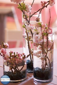 centerpiece idea; but with white cherry blossom and incorporate some blue or purple.