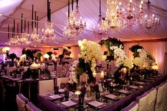 #glam #party look #wedding worthy #chandeliers everywhere #pink lighting with #black decor