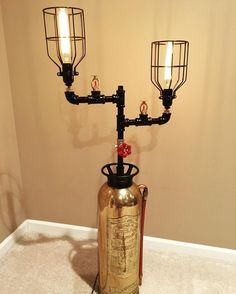 This is a vintage fire extinguisher that we converted in to an industrial table…