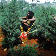 Peter Tosh poses  in Westmoreland, Jamaica circa 1975.