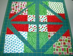1 - Disappearing Nine Patch that has been cut vertically, horizontally, and diagonally through each corner  - from Denise McKay / Beyond Sock Monkeys blog;  Use different pieces of the subcuts to create 4 different smaller blocks.  Each of the four new blocks create different quilt patterns.