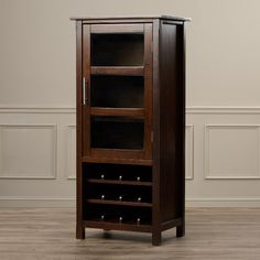 Found it at Wayfair - Avalon Bar Cabinet with Wine Storage - Dave really liked this one.