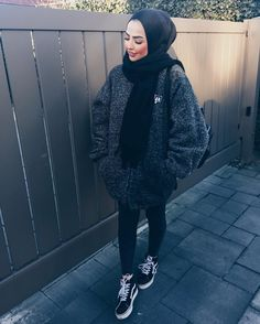 Sauf | black hijab/scarf + black gray white blend oversized sweater + black skinny jeans / leggings + black Vans high tops sneakers