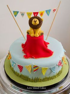 GEORGIE'S CIRCUS LION BIRTHDAY CAKE  Birthday cake with lots of sugar bunting and a cute Lion