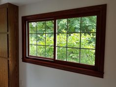 Wood Clad interior Gliding window with Colonial Grilles upgrades failing windows from 1985.