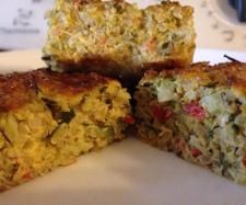 Quinoa Vegetable Quiche Makes 2 medium sized quiches  1 cup quinoa, (Dry measurement) 1 litre water 1 tbsp chia seeds 200 g milk 100 g Cheddar cheese 1 red capsicum, small, cut into chunks 1 zucchini, cut into chunks 1 broccoli, small, cut into chunks 1 onion, peeled and quartered 1 clove garlic 1 bunch parsley 10-15 leaves basil 6 eggs salt and pepper to taste