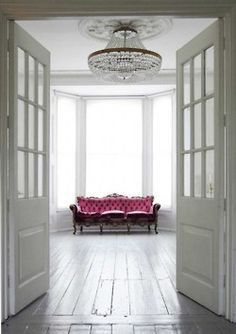 pink settee and white wood floors!