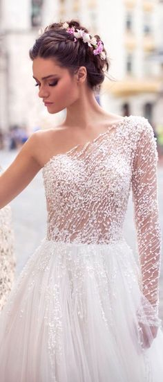 White bride dresses. Brides dream of having the perfect wedding day, however for this they require the best bridal dress, with the bridesmaid's outfits complimenting the brides-to-be dress. The following are a variety of suggestions on wedding dresses.