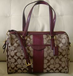 The Coach Signature Stripe Nancy Satchel in Khaki/Merlot is one of my favorite Coach bags. It is a Coach Classic with a deep burgundy stripe down the center, balanced out with Coach Khaki Signature fabric throughout accented with rich patent fabric trim.  Its' finale is the gold hardware which co...