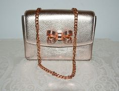 06370712bf75 Ted Baker London Bow Detail Rose Gold Bronze Leather Cross Body Bag -  Tradesy Bow Clutch