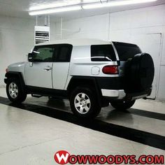 FJ Cruiser.  I really like the look of these.  Too bad the back seat has so little leg room.  For a family of tall people this just won't work.