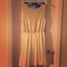 Charming Charlie dress Perfect for a night out! The front neckline is a scoop neck, synching at the natural waist. The bottom of the dress is a flowy cream colored shear material. The back is a deep V with a gold zipper! Worn only once! Charming Charlie Dresses Mini