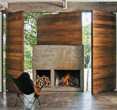 concrete fireplace with wood panels