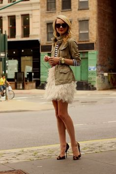 Feather skirts are one of my latest obsessions. I love how she paired it with more of a structured jacket! #SocialblissStyle #feathers