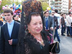 A lady wearing her mantilla (lace  shawl) on Jueves Santo (Holy Thursday) in Seville. They're also worn at bullfights and weddings (in white).