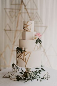 modern white and gold wedding cake