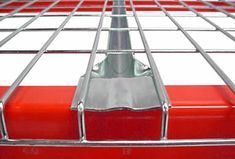 A part of the flared channel wire decking with galvanized surface waterfalls over the red racks. Boltless Shelving, Roll Cage, Stainless Steel Wire, Wire Mesh, Sprinkler, Steel Material, Wooden Pallets, Particle Board, Beams