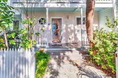Ever dream of vacationing in a sun-kissed Caribbean Cottage-style flat close to the beach, nestled behind a white picket fence in a landscaped tropical garden? Sweet Sunshine Garden Flat can make that dream come true. Tropical Landscaping, Tropical Garden, Key West Rentals, Lime Green Walls, Small Entry, Cream Walls, Victorian Cottage, White Picket Fence, Cottage Style Homes