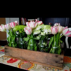 Our Easter centerpiece... Hubby made box out of pallets.... Mason jars n fresh flowers