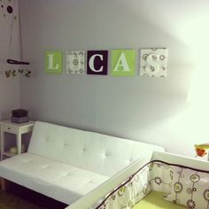 Totally have that couch in black didn't think it could look cute staying in the nursery! Love the name display