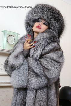 Swathed in Silver Fox Fur's, Long Red Nail's. www.fetishmistressuk.com