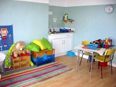 play therapy room. sink and art table are good.