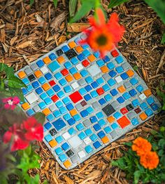 Mosaic Stepping-Stone.  Use square cake pan sprayed with non-stick and mosaic tiles from Home store.