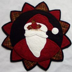 Penny Rug Santa Claus Candle and Table Mat by Happy Valley Primitives. $49.95, via Etsy.