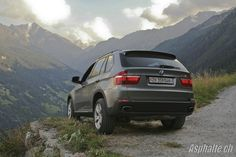 BMW X5 4.8i E70 overlooking an alpine valley, a symbol of the increasing share of SUVs in the auto market. When we published this review in 2007, SUVs were stigmatized by Greenpeace and the swiss green party. In October 2012, 4x4 sales in Switzerland represented 36% of the total market.