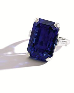 Lot 324. Property Formerly from the Estate of Marianne Gould McDonough and Thence by Descent. Platinum, Sapphire and Diamond Ring by John Rubel. The emerald-cut sapphire weighing 31.34ct is flanked by two baguette diamonds weighing approximately 1.00ct, size 6, signed John Rubel & Co., numbered 4690, circa 1947. Sold for US$ 785,000 (estimate: US$ 200,000-$ 300,000). Courtesy of Sothebys.