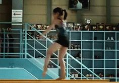 Gif of a Japanese gymnast doing a quad turn on beam (gif by allyoursecrets) // Um, amazing!