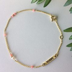 Armband Treasure Rookie goud roze met pareltje