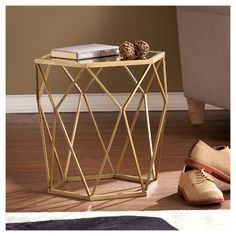 Let the striking opulence lure you in with the Aiden Lane Accent Table. Revealing, gold design creates a captivating shadow effect. In your living room or home office, this chic side table basks your home in geometric panache.