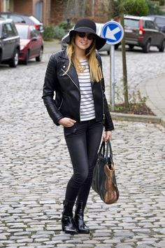 Leather jacket on a striped top and jeans