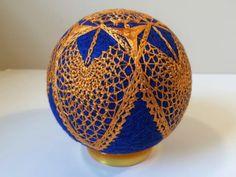 intriguing golden lace-like temari