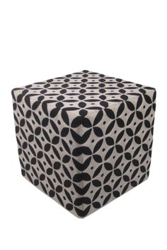 I like the idea of incorporating pattern in a small way like this, as opposed to a giant rug. Half Circle Chain Stitch Ottoman - Black