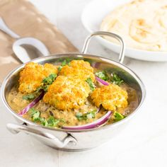 Roasted Cauliflower Curry | vegan entree cooked in nice thick creamy gravy with some aromatic herbs and spices and enhanced with Indian flavors that go well with naan/rice | kiipfit.com